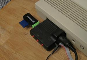 USB card reader plugged into 1541 Ultimate-II. Both this and the internal microSD card are accessible from the Ultimate menu.