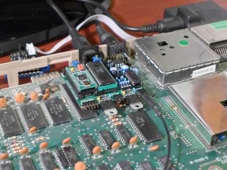 The stereo board covers the CPU, and the other regulator hovers above the PLA